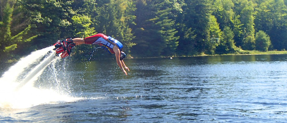 Flyboarding through the air is just one of the many FUN adventures to be had at Camp Muskoka!